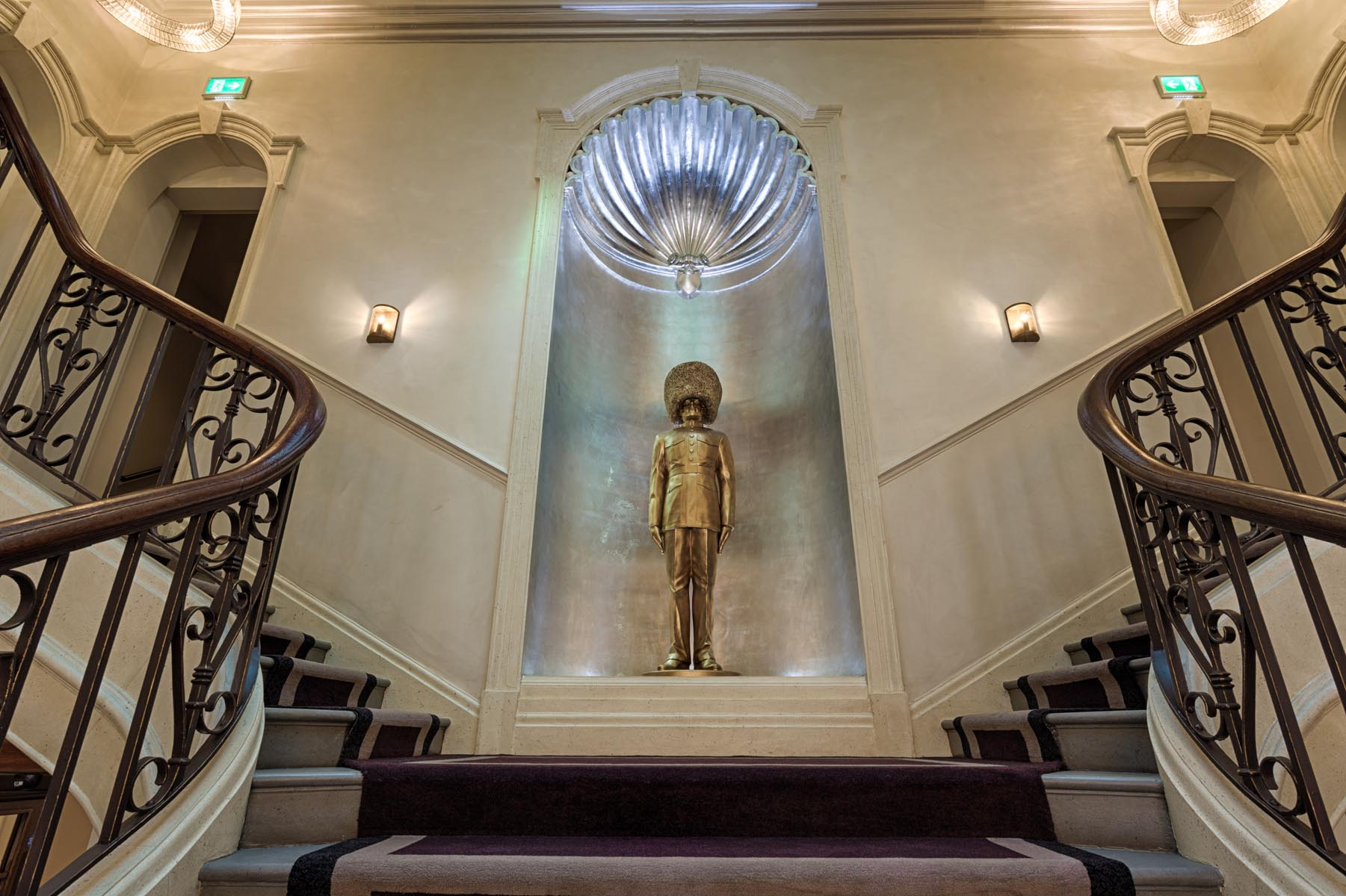 Stairwell in a hotel with shell efect and statue