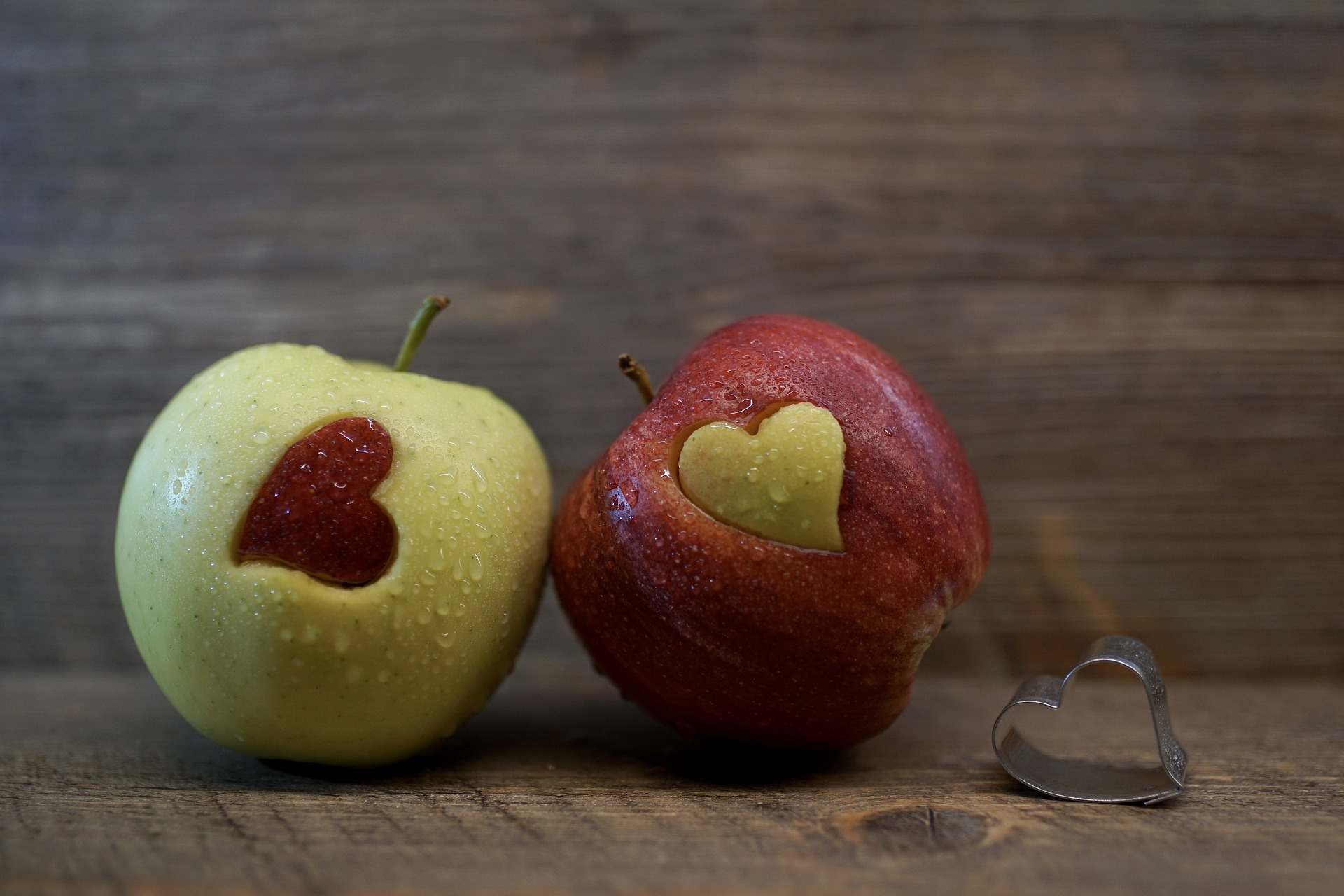 Two apples cut with hearts