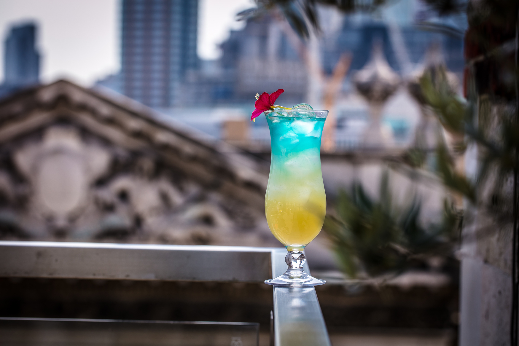Cocktail on a wall at a rooftop london bar